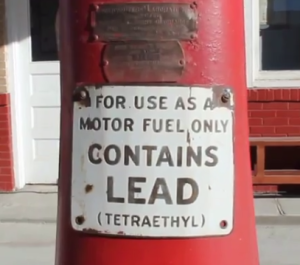 climate change fuel pump warning label